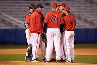Ball State Cardinals head coach Rich Maloney (2) talks with starting pitcher Zach Plesac (11) as catcher Jarett Rindfleisch (25), first baseman Caleb Stayton (34), and second baseman Ryan Spaulding (5) listen in during a game against the Wisconsin-Milwaukee Panthers on February 26, 2016 at Chain of Lakes Stadium in Winter Haven, Florida.  Ball State defeated Wisconsin-Milwaukee 11-5.  (Mike Janes/Four Seam Images)