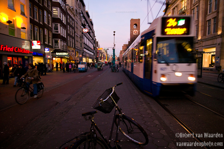 A tram on the Damrak, a main Amsterdam street leading to the famous Dam Square in this capital city of the Netherlands.
