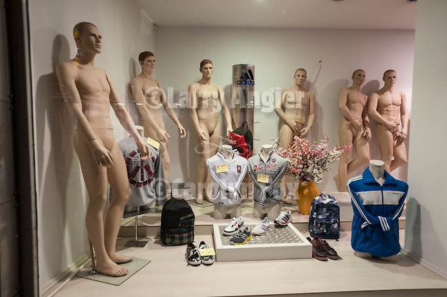 Naked mannequins in a shop window display, Trikala, Greece