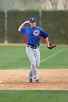 Matt Camp #58 of the Chicago Cubs participates in infield practice during spring training workouts at the Cubs complex on February 19, 2011  in Mesa, Arizona. .Photo by Bill Mitchell / Four Seam Images.