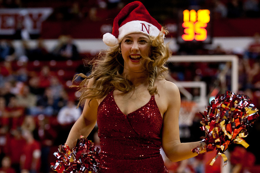 20 December 2011: Nebraska Cornhuskers  dance team member fires up the crowd with her Santa hat during a time out against the Central Michigan Chippewas at the Devaney Sports Center in Lincoln, Nebraska. Nebraska defeated Central Michigan 72 to 69.