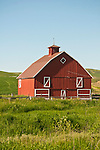 Red wooden barn with ventilator and white trim in Washington's Palouse.