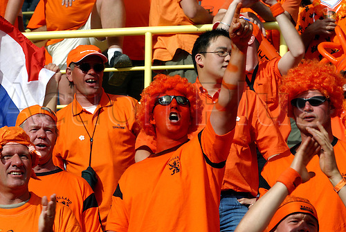 June 19, 2004: Dutch Supporter with a painted face in the crowd before the Euro 2004 Group D match between Czech Republic and Holland. The Czech Republic won the game 3-2 played at Municipal Stadium, Aveiro, Portugal. Photo: Neil Tingle/Action Plus..040619 football soccer UEFA European Championships Netherlands Dutch fans fan crowds