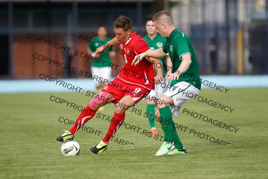 BELGRADE, SERBIA - JUNE 05: Frey Michael of Switzerland (L) and Steven Smith of Ireland (R) during the UEFA European Under-19 Championship Elite Round football match between Ireland and Switzerland on June 05, 2013 in Belgtrade, Serbia (credit: Pedja Milosavljevic  / thepedja@gmail.com / +381641260959)