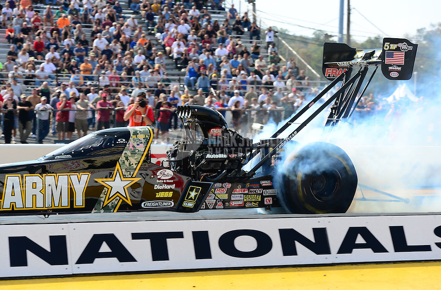 Oct. 5, 2012; Mohnton, PA, USA: NHRA top fuel dragster driver Tony Schumacher during qualifying for the Auto Plus Nationals at Maple Grove Raceway. Mandatory Credit: Mark J. Rebilas-