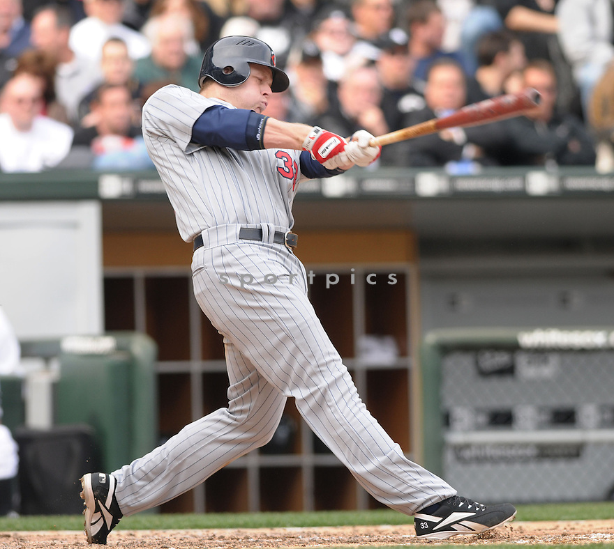 JUSTIN MORNEAU, of the  Minnesota Twins in action  during the Twins game against the Chicago White Sox .  The White Sox beat the Twins 7-4 in Chicago, Illinois on April 7, 2008...David Durochik