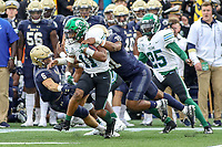 Annapolis, MD - October 26, 2019: Tulane Green Wave running back Amare Jones (11) gets tackled by several Navy Midshipmen defenders during the game between Tulane and Navy at  Navy-Marine Corps Memorial Stadium in Annapolis, MD.   (Photo by Elliott Brown/Media Images International)