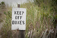 "A ""keep of dunes"" sign is pictured by the beach in Ocean Beach on Fire Island in New York state, Wednesday August 3, 2011. The incorporated villages of Ocean Beach and Saltaire within Fire Island National Seashore are car-free during the summer tourist season and permit only pedestrian and bicycle traffic."