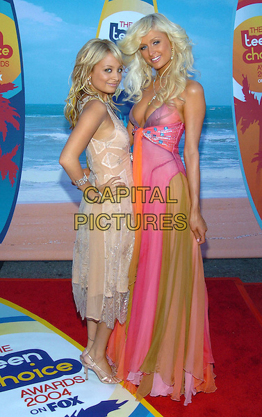 NICOLE RICHIE & PARIS HILTON.At the 2004 Teen Choice Awards held at Uiversal Amphitheatre, Universal City, CA, USA,.8th August 2004..full length big flicked out hair long chiffon multi-coloured dress orange pink green peach beaded dress..**UK SALES ONLY**.Ref: ADM.www.capitalpictures.com.sales@capitalpictures.com.©Capital Pictures.