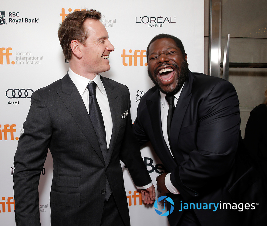 """Michael Fassbender and Director Steve McQueen are seen at Fox Searchlight's Premiere of """"12 Years A Slave"""", on Friday, September 6th, 2013 in Toronto, Canada. (Photo by Todd Williamson/Invision for Fox Searchlight/AP Images)"""