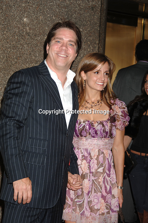 Andy Hilfiger and date..arriving at The Conde Nast Media Group's Third Annual Live Fashion Rocks Concert at Radio City Music Hall on September 7, 2006. ..Robin Platzer, Twin Images