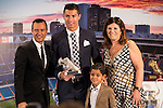 Cristiano Ronaldo poses with the award for top scorer with her mum, Maria Dolores Dos Santos Aveiro and her son Cristiano Ronaldo JR. during the tribute to Cristiano Ronaldo by Real Madrid CF on the occasion of his new record by being the top scorer in the club's history at Santiago Bernabeu Stadium in Madrid, October 02, 2015.<br /> (ALTERPHOTOS/BorjaB.Hojas)