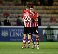 Lincoln City's Harry Anderson, left, celebrates the win with team-mate Lee Frecklington at the end of the game<br /> <br /> Photographer Chris Vaughan/CameraSport<br /> <br /> The Emirates FA Cup Second Round - Lincoln City v Carlisle United - Saturday 1st December 2018 - Sincil Bank - Lincoln<br />  <br /> World Copyright © 2018 CameraSport. All rights reserved. 43 Linden Ave. Countesthorpe. Leicester. England. LE8 5PG - Tel: +44 (0) 116 277 4147 - admin@camerasport.com - www.camerasport.com