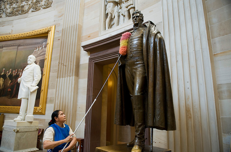 UNITED STATES - JANUARY 04:  Maria Bernal de Navarratte dusts a statue of Andrew Jackson, seventh President of the United States, in the rotunda of the Capitol. (Photo By Tom Williams/Roll Call)