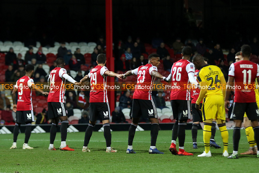 An unusual defensive ploy from the Brentford players as they touch hands while waiting for an Oxford United corner to be taken during Brentford vs Oxford United, Emirates FA Cup Football at Griffin Park on 5th January 2019