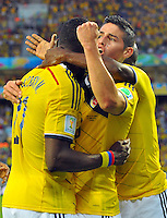 CUIABA - BRASIL -24-06-2014. James Rodriguez (#10), Jackson Martinez (#21) y Pablo Armero (#7) jugadores de Colombia (COL) celebran un gol anotado a Japón (JPN) durante partido del Grupo C de la Copa Mundial de la FIFA Brasil 2014 jugado en el estadio Arena Pantanal de Cuiaba./ James Rodriguez (#10), Jackson Martinez (#21) and Pablo Armero (#7) players of Colombia (COL) celebrate a goal scored to Japan (JPN) during the macth of the Group C of the 2014 FIFA World Cup Brazil played at Arena Pantanal stadium in Cuiaba. Photo: VizzorImage / Alfredo Gutiérrez / Contribuidor