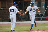 30 july 2010: Jairo Gizzi of Italy is congratulated by Alberto Auria as he runs the bases after hitting an home run during Italy 9-2 win over France, in day 6 of the 2010 European Championship Seniors, at TV Cannstatt ballpark, in Stuttgart, Germany.
