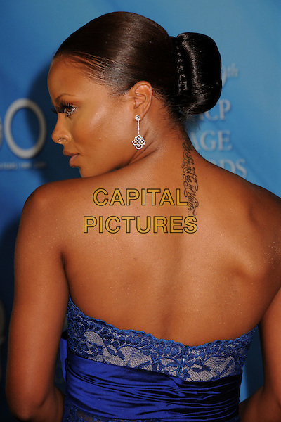 EVA MARCILLE PIGFORD.40th Annual NAACP Image Awards - Arrivals at the Shrine Auditorium, Los Angeles, California, USA..February 12th, 2009.half length blue lace strapless profile bun back behind rear tattoo dangling earring .CAP/ADM/BP.©Byron Purvis/AdMedia/Capital Pictures.