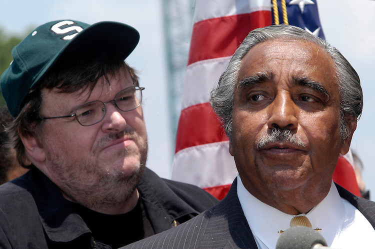 "Filmmaker Michael Moore appeared with Rep. Charlie Rangel, D-NY, and other members of the Congressional Black Caucus today, who were out in support of his new film, ""Farenheit 9/11."""