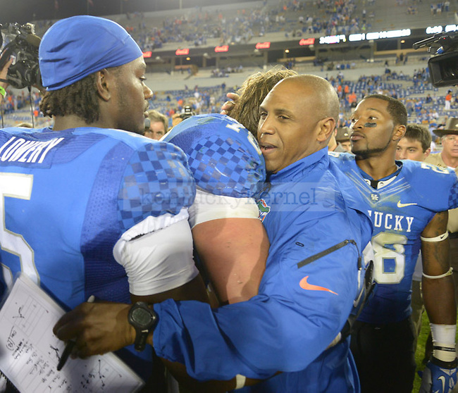 Joker Phillips, former UK head coach and current Florida wide receiver coach hugs his former players after the UK football game against Florida at Commonwealth Stadium in Lexington, Ky., on Saturday, September 28, 2013. Photo by Eleanor Hasken | Staff