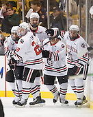 Rob Dongara (Northeastern - 39), Mike Hewkin (Northeastern - 28), Jamie Oleksiak (Northeastern - 6), Robbie Vrolyk (Northeastern - 91) and Mike McLaughlin (Northeastern - 18) celebrate McLauglin's second goal. - The Northeastern University Huskies defeated the Harvard University Crimson 4-0 in their Beanpot opener on Monday, February 7, 2011, at TD Garden in Boston, Massachusetts.