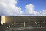 An empty parking lot with the sky, clouds, and sea wall in San Juan, Puerto Rico