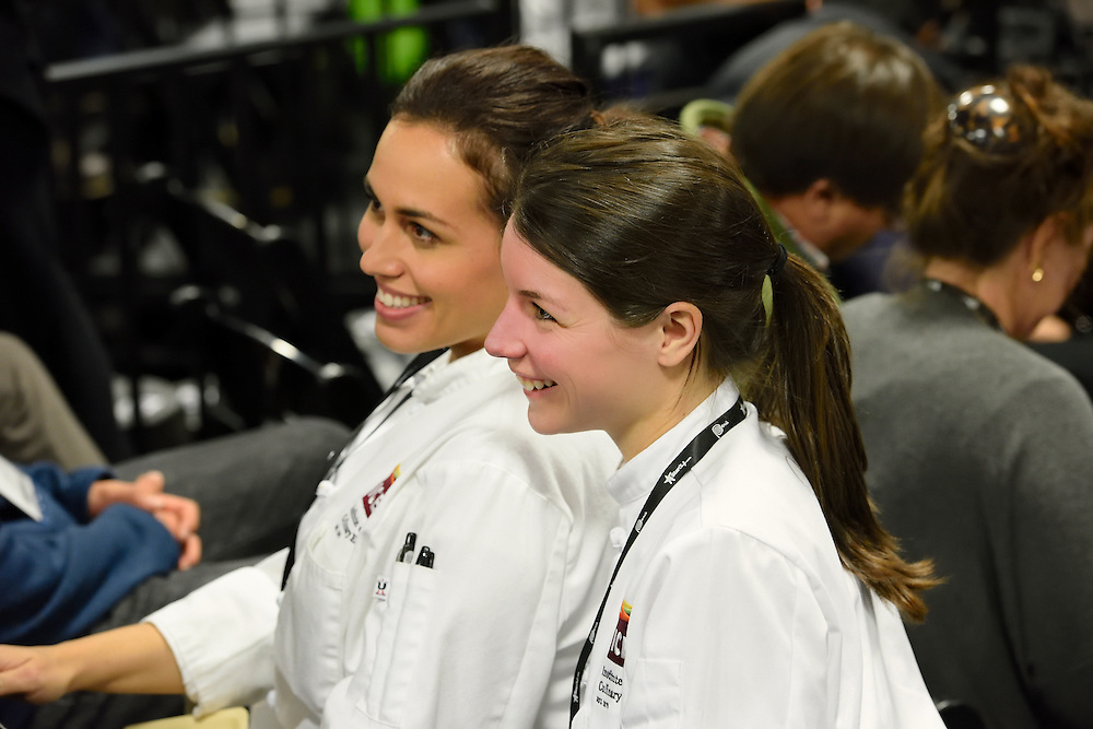 Candid photo of two female chefs at the StarChefs Congress.