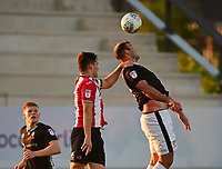 Lincoln City's Matt Rhead vies for possession with Exeter City's Jordan Moore-Taylor<br /> <br /> Photographer Andrew Vaughan/CameraSport<br /> <br /> The EFL Sky Bet League Two Play Off Second Leg - Exeter City v Lincoln City - Thursday 17th May 2018 - St James Park - Exeter<br /> <br /> World Copyright &copy; 2018 CameraSport. All rights reserved. 43 Linden Ave. Countesthorpe. Leicester. England. LE8 5PG - Tel: +44 (0) 116 277 4147 - admin@camerasport.com - www.camerasport.com