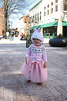 Girl in bunny hat on the downtown mall.