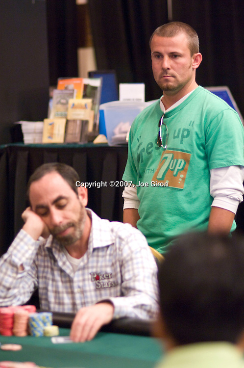 Before being seated at the same table, Joe Sebok comes over from his to see how dad, Barry, is doing.