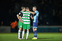 Garry Thompson of Wycombe Wanderers with former teammate Ryan Dickson (11) of Yeovil Town after the Sky Bet League 2 match between Wycombe Wanderers and Yeovil Town at Adams Park, High Wycombe, England on 14 January 2017. Photo by Andy Rowland / PRiME Media Images.