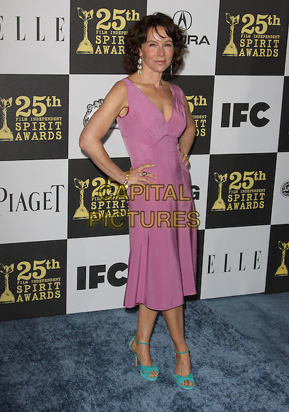 JENNIFER GREY .25th Annual Film Independent Spirit Awards held At The Nokia LA Live, Los Angeles, California, USA,.March 5th, 2010 ..arrivals Indie Spirit  full length pink dress hands on hips sleeveless green ankle strap open toe sandals shoes ring gold bracelet .CAP/ADM/KB.©Kevan Brooks/Admedia/Capital Pictures