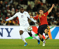 Jozy Altidore of USA and Joan Capdevila of Spain. USA defeated Spain 2-0 during the semi-finals of the FIFA Confederations Cup at Free State Stadium in Manguang/Bloemfontein, South Africa on June 24, 2009..