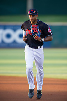 AZL Indians center fielder Quentin Holmes (70) jogs off the field between innings of the game against the AZL Rangers on August 26, 2017 at Goodyear Ball Park in Goodyear, Arizona. AZL Indians defeated the AZL Rangers 5-3. (Zachary Lucy/Four Seam Images)
