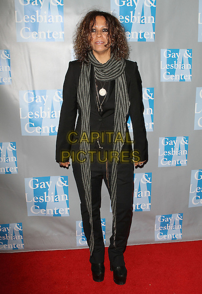 "LINDA PERRY.L.A. Gay & Lesbian Center's ""An Evening With Women"" held at The Beverly Hilton Hotel, Beverly Hills, California, USA..April 16th, 2011.full length  black suit jacket jeans denim grey gray scarf .CAP/ADM/KB.©Kevan Brooks/AdMedia/Capital Pictures."