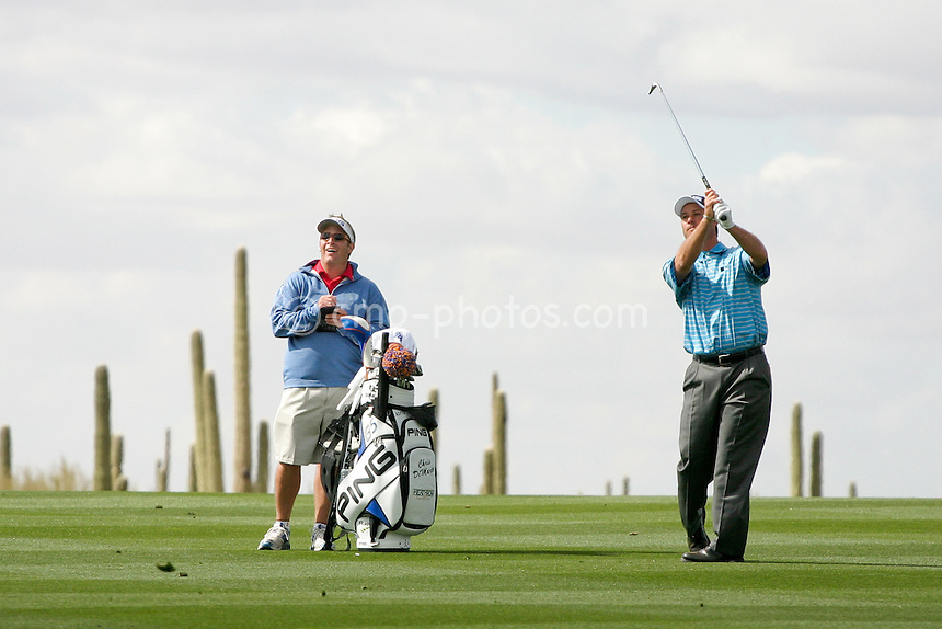 Feb. 20, 2007; Marana, AZ, USA; Chris DiMarco watches his approach shot to the 11th green during a tuesday practice round prior to the World Golf Championships' Accenture Match Play Championship at the Gallery Golf Club at Dove Mountain.