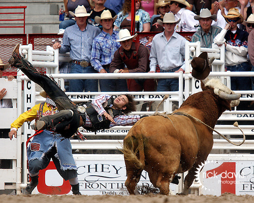 PRCA cowboy Clayton Savage gets blown right out of his hat by the bull Red Eye during final round action at the 112th annual Cheyenne Frontier Days Rodeo on July 27, 2008 in Cheyenne, Wyoming.