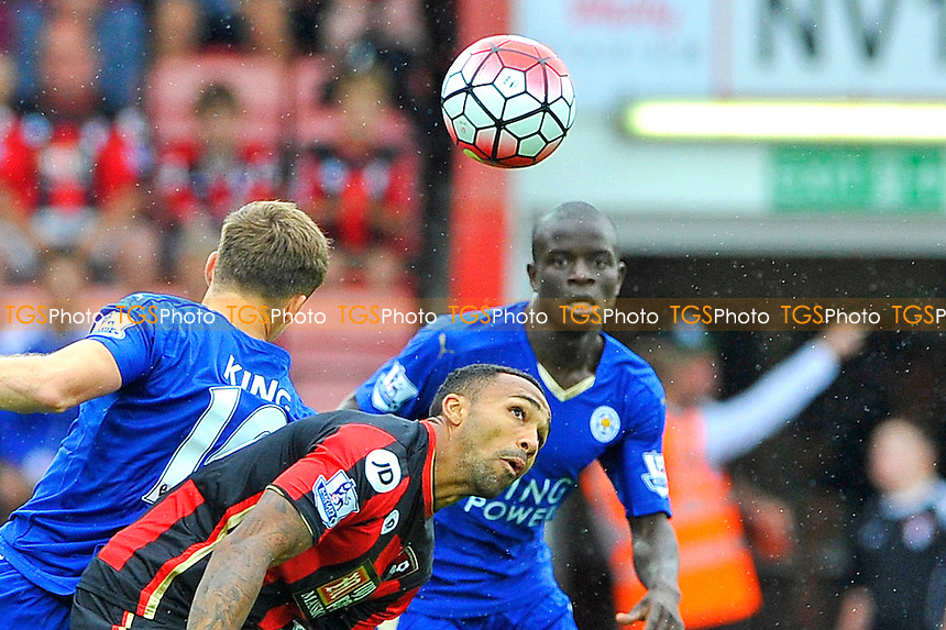 Callum Wilson of AFC Bournemouth keeps his eye on the ball despite pressure from Andy King of Leicester City during AFC Bournemouth vs Leicester City