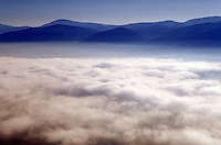 Ground fog shrouds the floor of the Shenandoah Valley, as the Blue Ridge Mountains (part of the Appalachian Mtns.) rise in the background. Virginia USA Shenandoah Valley.