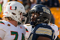 Miami Hurricanes offensive lineman Tyler Gauthier and Pitt Panthers defensive lineman Amir Watts face off against each other. The Pitt Panthers upset the undefeated Miami Hurricanes 24-14 on November 24, 2017 at Heinz Field, Pittsburgh, Pennsylvania.