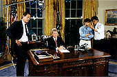 Washington, DC - (FILE) -- United States President Bill Clinton prepares to address the nation from the Oval Office of the White House in Washington, D.C. on Saturday, June 26, 1993.  He spoke on the successful bombing of Iraq earlier in the day.  Pictured from left to right: Vice President Al Gore, President Clinton, Communications Director George Stephanopoulos, and Steve Rabinowitz..Credit: White House via CNP