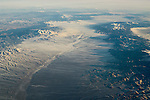 Aerial view over river basin and valley between mountains in winter in the Great Basin; Nevada