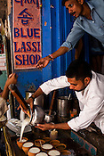 Chanchal Yadav pours glasses of lassi (yogurt drink) in his shop, The Blue Lassi that is quite a hit with the korean tourists in the ancient city of Varanasi in Uttar Pradesh, India. Photograph: Sanjit Das/Panos