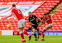 Barnsley's midfielder Joe Williams (4) clears the ball under pressure from Leeds United's forward Kemar Roofe (7) during the Sky Bet Championship match between Barnsley and Leeds United at Oakwell, Barnsley, England on 25 November 2017. Photo by Stephen Buckley / PRiME Media Images.