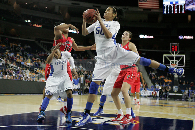 UK forward Azia Bishop grabs a rebound during the second half of the University of Kentucky women's basketball game vs. University of Georgia during the SEC tournament The Arena at Gwinnett Center in Duluth, Ga. on Saturday, March 9, 2013. UK's ability to get the rebound was a key component to their success and large lead in the second half. UK won 68-30. Photo by Genevieve Adams | Staff