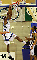 Saints forward Damon Thornton slamdunks during the NBL match between the Wellington Saints and Christchurch Cougars at Te Rauparaha Stadium, Porirua, Wellington, New Zealand on Saturday 4 April 2009. Photo: Dave Lintott / lintottphoto.co.nz
