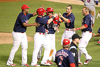 Memphis Redbirds catcher Tony Cruz #18 is mobbed by teammates Victor Marte #53, Aaron Luna #27, Donovan Solana #3, Pete Kozma #8, and Andrew Brown #24 after Cruz hit a walk off single during a game versus the Round Rock Express at Autozone Park on April 28, 2011 in Memphis, Tennessee.  Memphis defeated Round Rock by the score of 6-5 in ten innings.  Photo By Mike Janes/Four Seam Images
