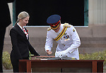 AUSTRALIA, Canberra : Captain Wales signs the visitors book after laying a wreath at the Australian War Memorial, Canberra on 6 April 2015. AFP PHOTO / MARK GRAHAM
