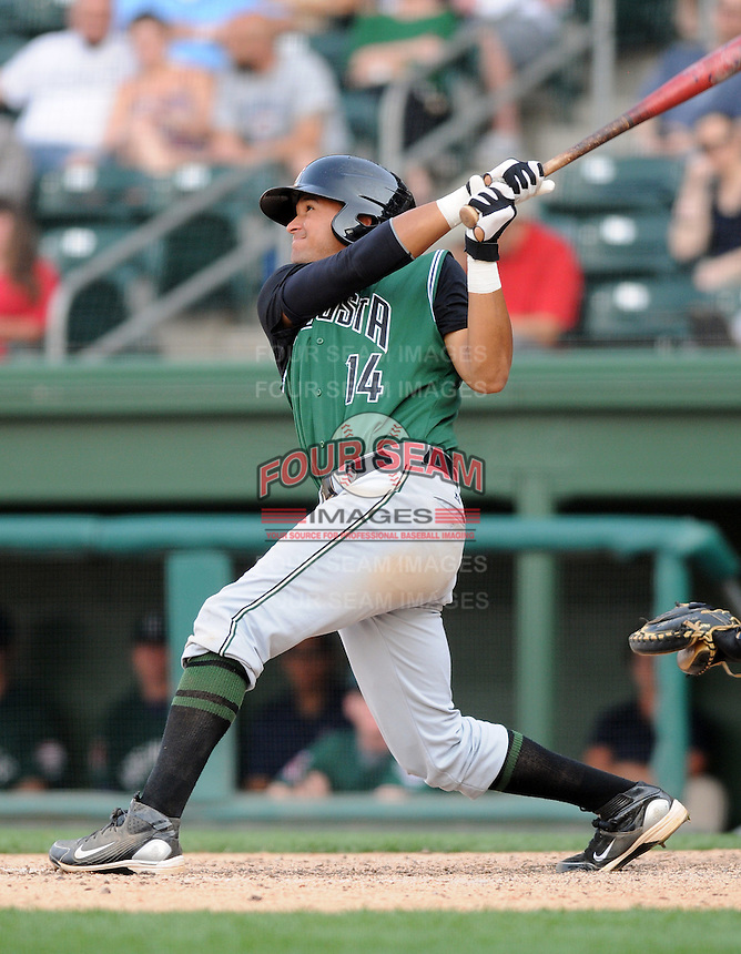 Infielder Ydwin Villegas (14) of the Augusta GreenJackets, Class A affiliate of the San Francisco Giants, in a game against the Greenville Drive on April 10, 2011, at Fluor Field at the West End in Greenville, S.C. Photo by Tom Priddy / Four Seam Images