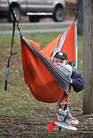 Seanan Finn, who is celebrating his 21st birthday today, took advantage of the warm morning temperatures Friday, January 10, 2020, to read in his hammock at Wilson Park in Fayetteville. Fin was reading Factfulness by Hans Rosling with Ola Rosling and Anna Rosling Ronnlund. Check out nwaonline.com/200111Daily/ and nwadg.com/photos for today's photo gallery.<br /> (NWA Democrat-Gazette/David Gottschalk)